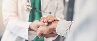 medical professionals shaking hands