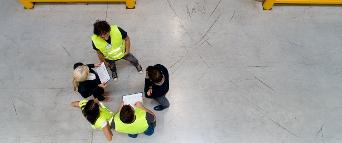 team meeting on factory floor